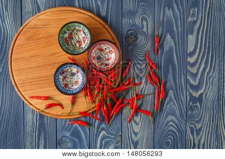 Fresh Red Hot Peppers And Pepper's Mix On The Wood