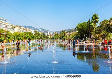 NICE, FRANCE - AUGUST 28, 2016: People among fountains at Promenade du Paillon - 12 hectares, 1.2km long new green pedestrian walkway area in the heart of Nice, France