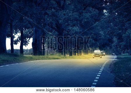 Cars moving on the road at night in summer