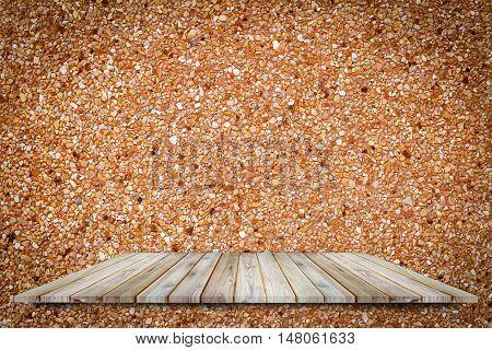 Teak wood shelf on concrete rough surface use for background.