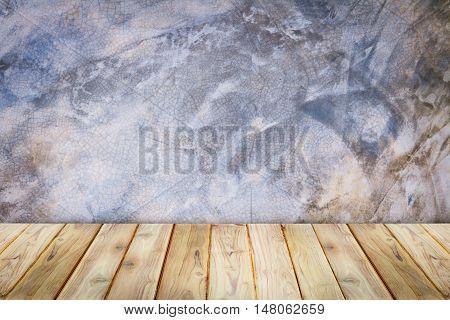Teak wood shelf on wall texture loft style background.