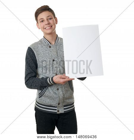 Cute teenager boy in gray sweater holding paper bill board over white isolated background, half body