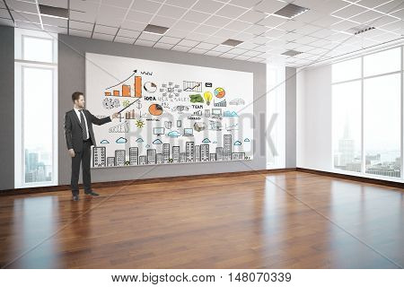 Young businessman delivering presentation in interior with creative business sketch on billboard wooden floor patterned ceiling window with city view and daylight. Success concept 3D Rendering
