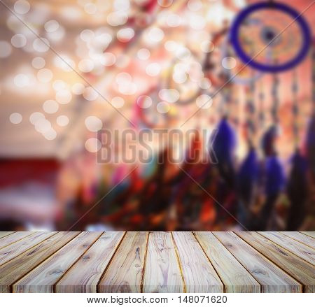 Perspective teak wood and blur dreamcatcher with bokeh use for background.