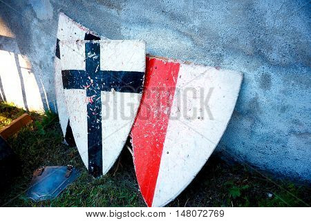 set of middle age style weapons, two knight shields