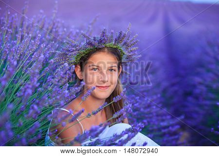 Beautiful young girl in the lavander fields in Valensole. Provence, France.