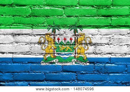 Flag Of Sierra Leone With Coat Of Arms, Painted On Brick Wall
