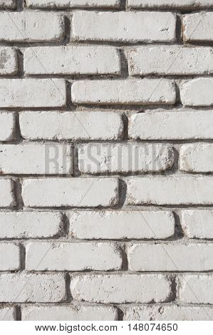 Brick grunge white wall. Old masonry texture