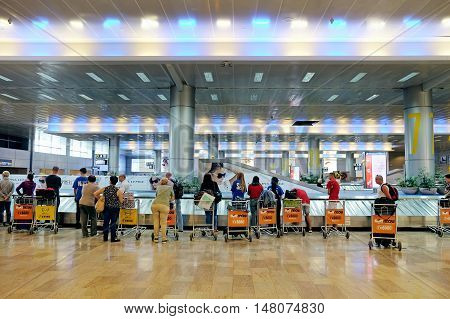 BEN GURION ISRAEL - SEPTEMBER 02 2016: Passengers expect luggage in the baggage hall of Ben Gurion Airport