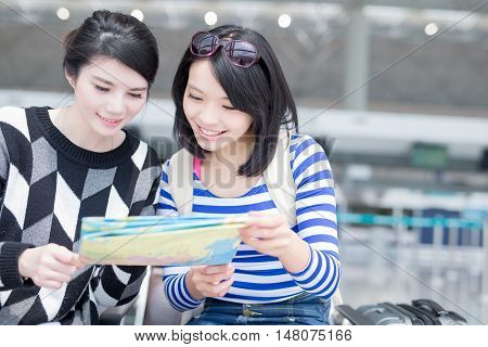 Happy group travel women hold map and smile. shot in hong kong asian