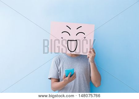 man holding happy expression billboard and take phone isolated on blue background