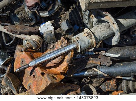 Useless worn out old rusty car parts