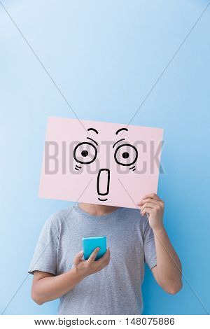 man holding surprise expression billboard and take phone isolated on blue background
