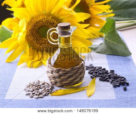 Flowers With A Bottle Of Sunflower Oil