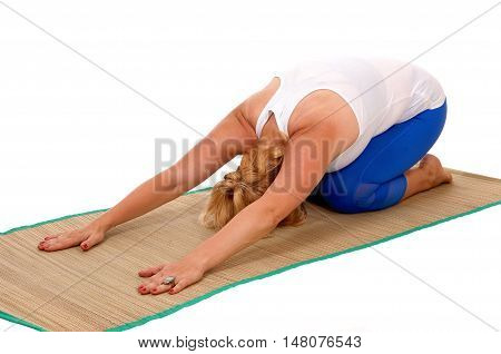 A lovely blond woman in yoga outfit kneeling on her stomach showing some yoga exercises isolated for white background.