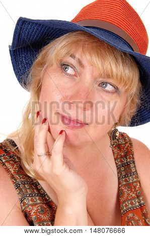 A portrait image of a pretty blond woman in a dress wearing a summer hat isolated for white background.