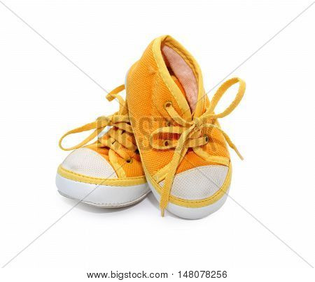 Nice yellow baby shoes on white background. Clipping path is included