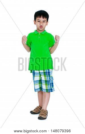 Strong and confident child. Full body of happy asian child in leather shoes looking at camera. Stylish boy having fun. Isolated on white background. Studio shot. Positive human emotion.