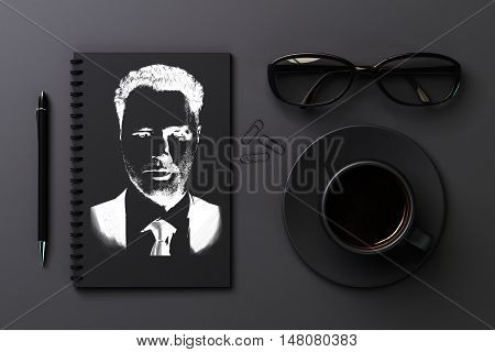 Top view of black desktop with drawn businessman portrait in spiral notepad coffee cup glasses pen and paper clips. 3D Rendering