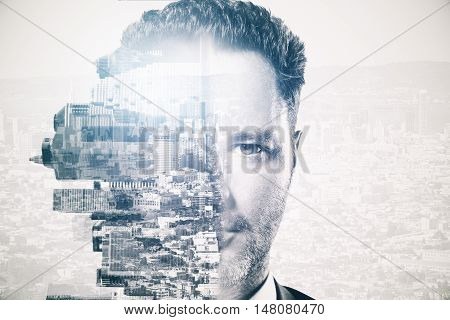 Half of caucasian man's face and rotated sideways city on abstract background with light. Double exposure