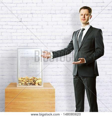 Businessman Showing Donation Box