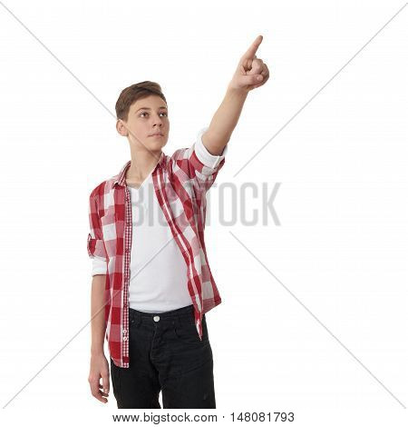 Cute teenager boy in red checkered shirt pointing up side over white isolated background, half body