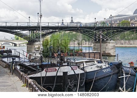 PARIS, FRANCE - AUGUST 06, 2016:  cargo ships on seine river near the pont des arts