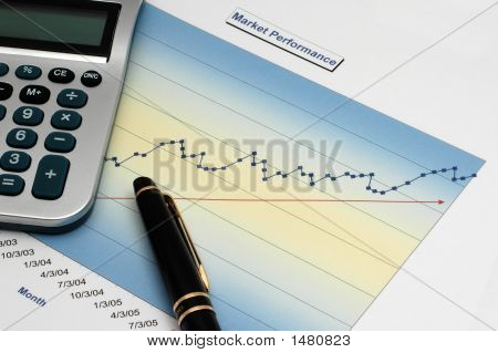 Stock Report With Calculator And Black Pen