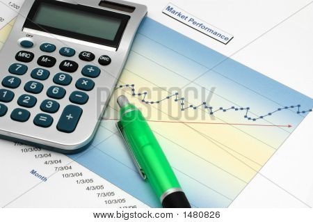 Stock Report With Calculator And Green Pen