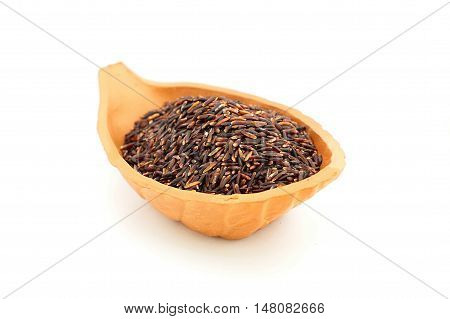 Grain black jasmine rice or Thai name is Hom Nil rice in clay ceramic bowl on white background.