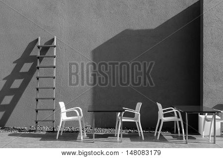 Light and shadow of tables chairs stairs and walls. Black and white tone