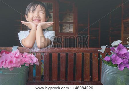 asian child girl smiling brightly with happiness.