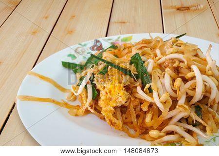 Stir fried rice noodles or Pad Mee Korat on the wooden table Pad ThaiThai food