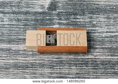 Creative wooden usb stick on dark background. Wooden USB flash drive on white and black table