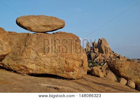 Big balancing granite boulder and mountain in Hampi India. Travel destination in India. Unique landscape. Popular region for bouldering.