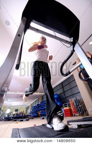 woman running on treadmill