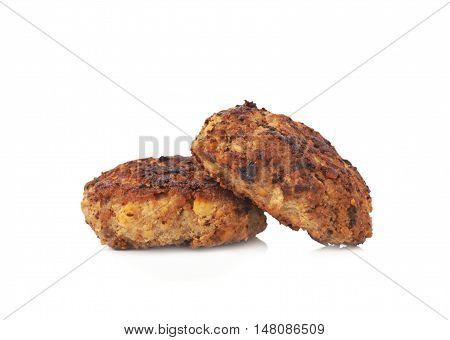 Couple of prepared small hand made cutlets isolated over white background