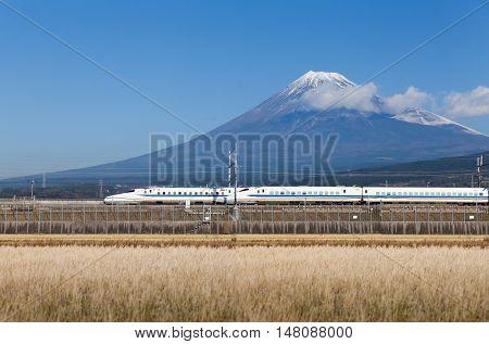Shizuoka - DEC 19 : Shinkansen bullet train and Mountain Fuji on DEC 19 , 2016 , Shizuoka, Japan. Shinkansen is world's busiest high-speed railway operated by four Japan Railways companies.