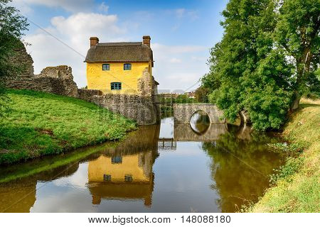 Cottage On A Moat