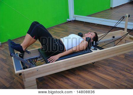 pretty girl exercising in fitness studio