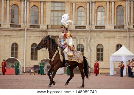 GATCHINA, ST. PETERSBURG, RUSSIA - SEPTEMBER 10, 2016: Actor in the image of count Orlov in the Roman costume in front of Gatchina palace during the festival Gatchinskaya Byl