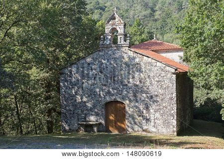 Isolated little old chapel in the forest in Galicia