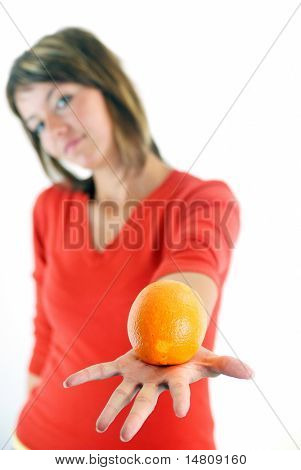 happy woman holding orange in hand