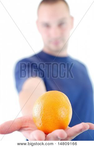 man holding orange in hand