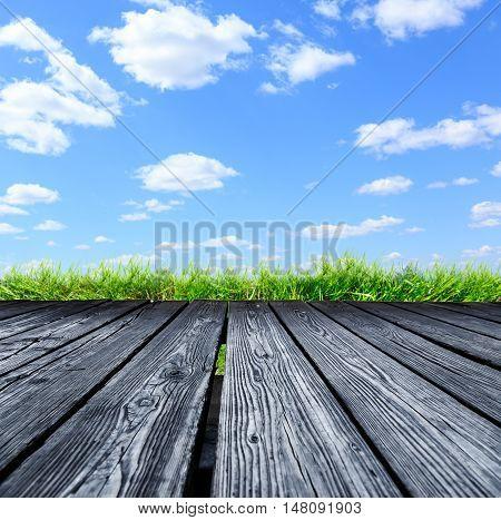 Rostrum Of Wooden Planks On Blue Sky