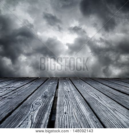 Rostrum Made Of Wooden Planks On Stormy Sky
