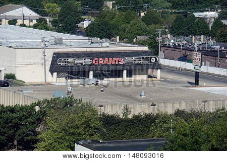 JOLIET, ILLINOIS / UNITED STATES - SEPTEMBER 4, 2016: The building of the former Grant's Appliance Store sits vacant in Joliet.