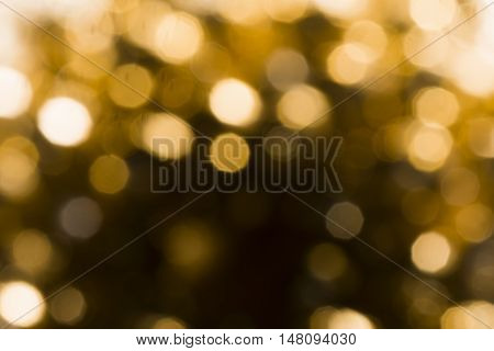 Golden shiny circles as blur texture background.