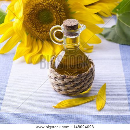 Sunflower oil in the decanter. Sunflower and oil in a glass decanter.