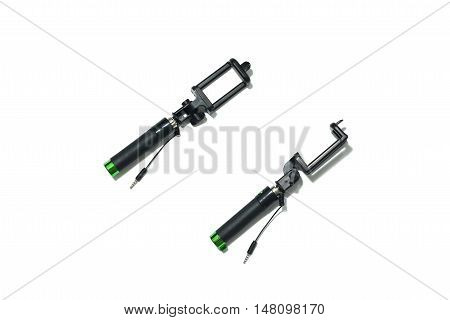 Close Up Top View An Extensible Selfie Stick With An Adjustable Clamp On The End Isolated On White B